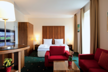Schlaf- und Wohnbereich Garden Studio Hotel
