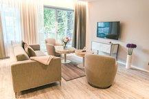 Wohnbereich mit Balkon Park Suite Hotel München Innenstadt