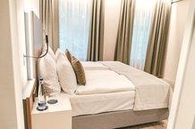 Schlafzimmer Rose Garden Suite Hotel München